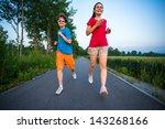 teenage girl and boy running ... | Shutterstock . vector #143268166