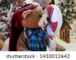 A Christmas Teddy Bear Holding...