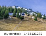"A gondola of the Cabrio cable car at the ""Kalti"" station. Stanserhorn Cabrio is the the world"