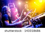 musician playing drums on stage - stock photo
