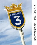 Small photo of Three furlong sign at Chester Racecourse.