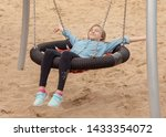 happy teen girl on swing in... | Shutterstock . vector #1433354072