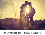 young couple with bike is... | Shutterstock . vector #1433423048