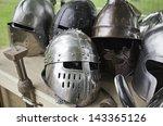 Постер, плакат: Old medieval helmets detail