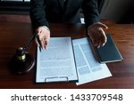lawyer working on the table in... | Shutterstock . vector #1433709548