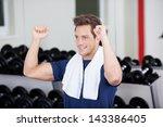 happy young man exercising in... | Shutterstock . vector #143386405