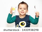 little kid eating yogurt on... | Shutterstock . vector #1433938298