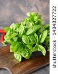 board with fresh green basil on ... | Shutterstock . vector #1434327722