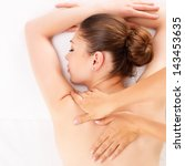 woman having massage of body in ... | Shutterstock . vector #143453635