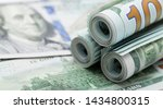 one hundred dollar bills are... | Shutterstock . vector #1434800315