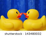 rubber duck couple sharing a...