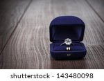 Ring In The Box On Wooden Table