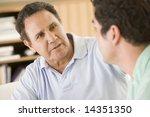 two men in living room talking | Shutterstock . vector #14351350