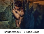 sexy woman trapped in stones | Shutterstock . vector #143562835