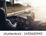 Interior of cab airport transfer bus with driver in motion on fast speed by highway - stock photo