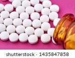 many white pills and brown vial ... | Shutterstock . vector #1435847858