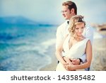 a wedding by the sea. honeymoon.... | Shutterstock . vector #143585482