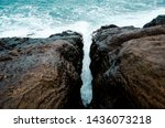Small photo of The storm waves hit the rocks of dale channel or reef to engender big foam when monsoon at the sea.