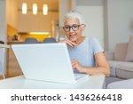 Elderly Woman Working On Laptop ...