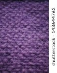 Violet knitting wool texture macro detail background vertical - stock photo