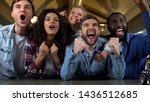 excited young people supporting ... | Shutterstock . vector #1436512685