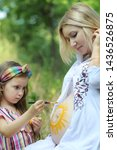 little girl draw a sun on her... | Shutterstock . vector #1436526875