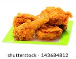 gold fried chicken on green... | Shutterstock . vector #143684812