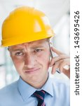engineer in hard hat talking on ... | Shutterstock . vector #143695426