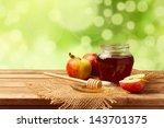 honey and apples on wooden... | Shutterstock . vector #143701375