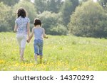 two girls walking away from... | Shutterstock . vector #14370292
