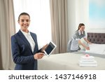 Small photo of Housekeeping manager with tablet checking maid work in hotel room. Space for text