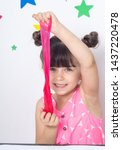 Cute funny girl play with slime....