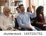Small photo of Training audience participants raise hands up ask question at conference workshop meeting sit on chairs, business people group voting participate corporate lecture conference seminar presentation