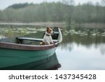Stock photo jack russell terrier in a boat on the lake a dog on the nature travel 1437345428