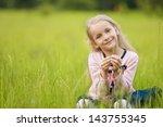 little girl sitting on the... | Shutterstock . vector #143755345