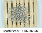 Paper clips on wooden pallet...