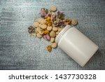 herbal pills with dry grass... | Shutterstock . vector #1437730328