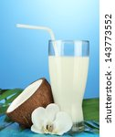 coconut with glass of milk   on ... | Shutterstock . vector #143773552