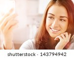 pretty young woman using mobile ... | Shutterstock . vector #143794942
