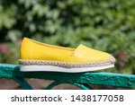 Stock photo yellow leather espadrilles close up yellow espadrilles on a background of green grass 1438177058