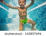underwater little kid close up... | Shutterstock . vector #143857696