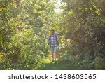 Stock photo adventures summer tourism and nature concept tourist arriving to a camping with his cat 1438603565