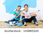 cute couple painting new home...   Shutterstock . vector #143883265