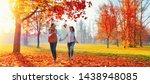 happy couple enjoying the fall... | Shutterstock . vector #1438948085
