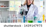 female scientist looking at... | Shutterstock . vector #1439147975
