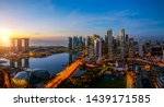 Singapore City And Sunrise Sky...