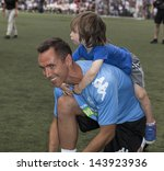 NEW YORK - JUNE 26: Steve Nash and son Matteo attend The Sixth Steve Nash Foundation Showdown at Sarah D. Roosevelt Park on June 26, 2013 in New York City. - stock photo