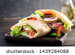 pita stuffed with chicken ... | Shutterstock . vector #1439284088