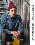 urban skateboarder with woolen... | Shutterstock . vector #143932036