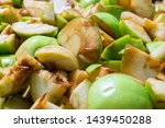 Ripe green apples sliced   into ...